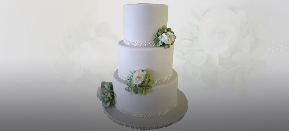 Custom tailor made to order Wedding Cakes by Persimmon Lane, Tauranga. Traditional and Modern Cakes Decorated with Icing Floral Arrangments a speciality.